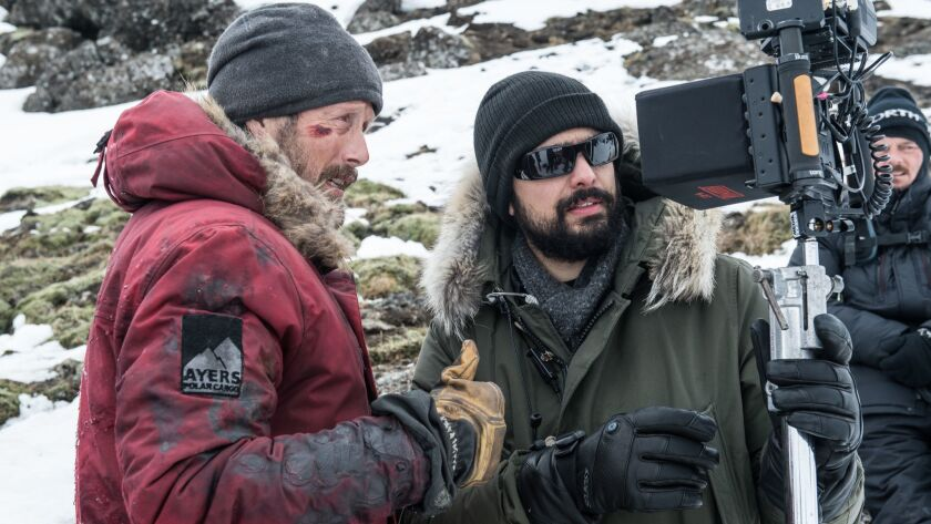 "Director Joe Penna on the set of ""Arctic"" wth actor Mads Mikkelsen at left. CREDIT: HELEN SLOAN SMPS"