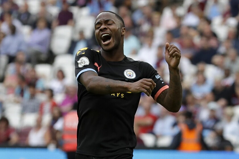 Raheem Sterling celebrates after scoring one of his three goals Saturday.