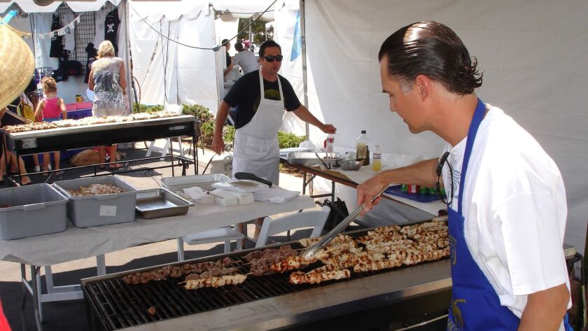 Volunteers grill Greek chicken at a past Greek Festival at Saints Constantine and Helen Greek Orthodox Church in Cardiff.