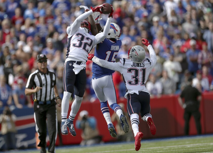 New England Patriots safety Devin McCourty (32) intercepts a pass intended for Buffalo Bills wide receiver John Brown (15) in the first half in Orchard Park, N.Y. on Sept. 29.