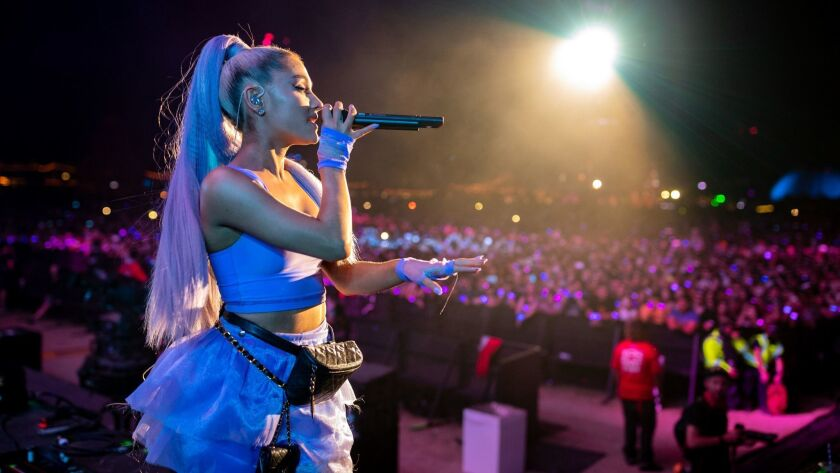 Ariana Grande performs at the Coachella Valley Music and Arts Festival. She fits many of the criteria that computers used to recognize successful songs.