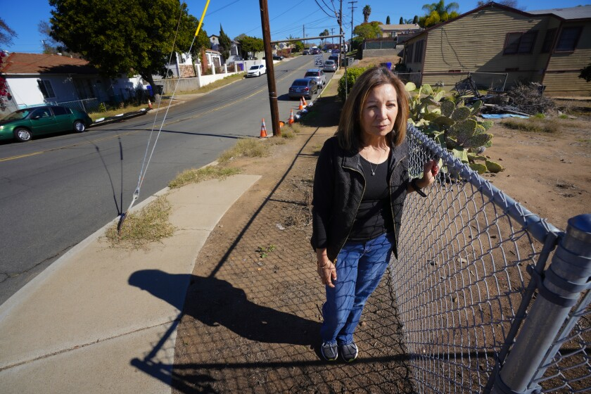 Bonnie Moreno stands where a sidewalk ends, at Rachael Avenue and Albemarle Street in Paradise Hills