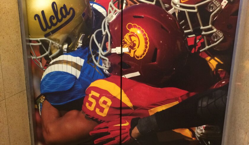 A giant photograph featuring suspended USC player Don Hill (59) adorns the press-box elevator door at the Coliseum.