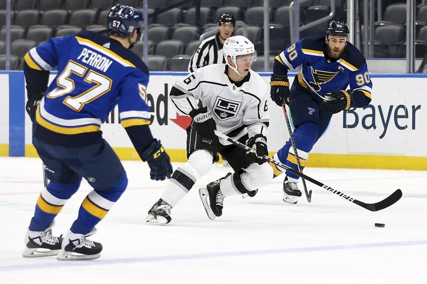Los Angeles Kings' Olli Maatta (6) controls the puck while under pressure from St. Louis Blues' Ryan O'Reilly (90) and David Perron (57) during the first period of an NHL hockey game Wednesday Feb. 24, 2021, in St. Louis. (AP Photo/Scott Kane)