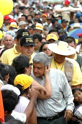 Leftist candidate Andres Manuel Lopez Obrador gets a kiss in Izamal, Mexico.