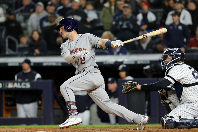 Houston Astros third baseman Alex Bregman singles during Game 5 of the ALCS against the New York Yankees.