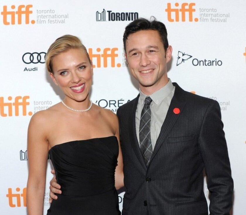 "Scarlett Johansson and Joseph Gordon-Levitt at the Toronto International Film Festival screening of ""Don Jon."""