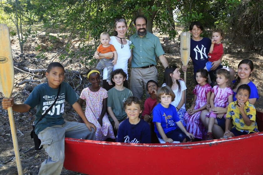 Ella and Richard Zuelsdorf have 13 children, eight are their own, five are adopted. They live in an 11-bedroom house on 12 acres in Escondido. Front row from left: Aaron, 11 (holding oar); Ezra, 9; Job, 4;, Christo, 7; Askale (in yellow headband), 8; Josiah, 8; Anthony, 9; Mena, 11; Ilona, 6; Marjo