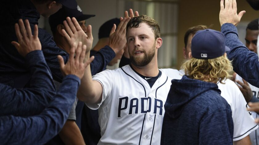 Jordan Lyles, who allowed two runs in seven innings, is congratulated after scoring during the second inning of the Padres victory over the Marlins on Thursday.