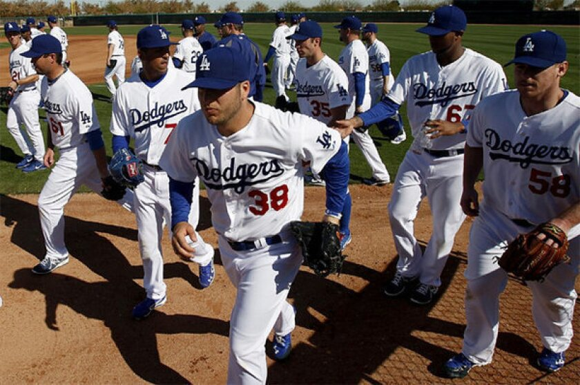 Dodgers plan to televise games in three languages in 2014