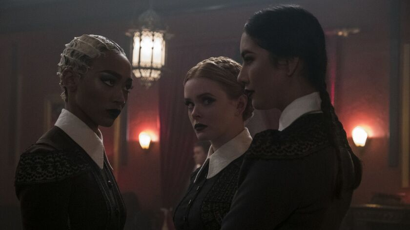 "Tati Gabrielle, left, Abigail Cowen, Adeline Rudolph in a scene from ""Chilling Adventures of Sabrina."""