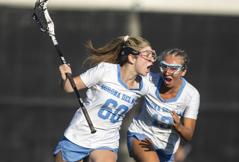 Corona del Mar's Haile Franklin, right, celebrates with Shelby Glabman, left, after Glabman scored a goal against Canyon.