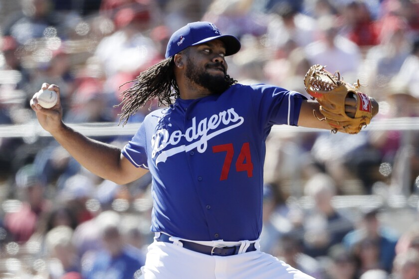 Dodgers relief pitcher Kenley Jansen works against an Angels batter during the second inning of a spring training game on Wednesday in Phoenix.