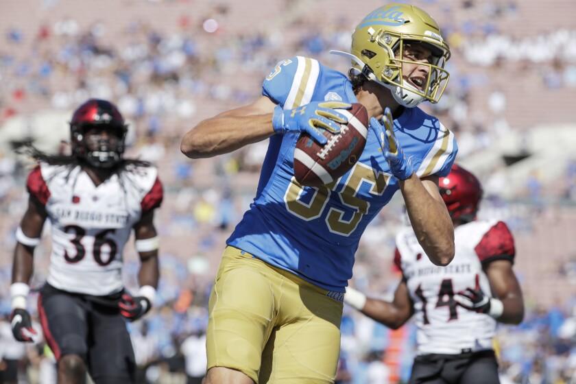 Greg Dulcich scores a touchdown against San Diego State.