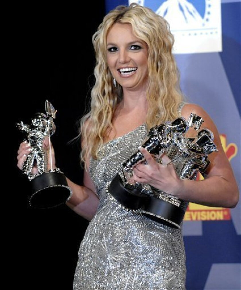 In this Sept. 7, 2008 file photo, Britney Spears poses with her awards backstage at the 2008 MTV Video Music Awards in Los Angeles. (AP Photo/Chris Pizzello, file)