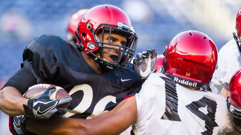 San Diego State redshirt freshman running back Kaegun Williams (left) produced the only touchdown of Saturday's scrimmage, scoring on a 56-yard run.