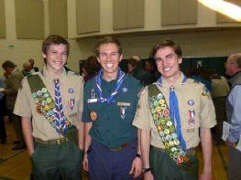 David Claxton and Dillon Lerach are congratulated by Pacific Ridge alumnus and Eagle Scout, David Hines '11 (center).