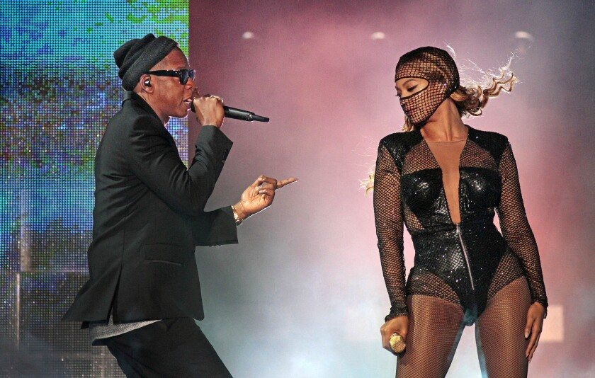 Jay Z appears with Beyoncé as part of their On the Run tour at the Rose Bowl in Pasadena in August 2014.