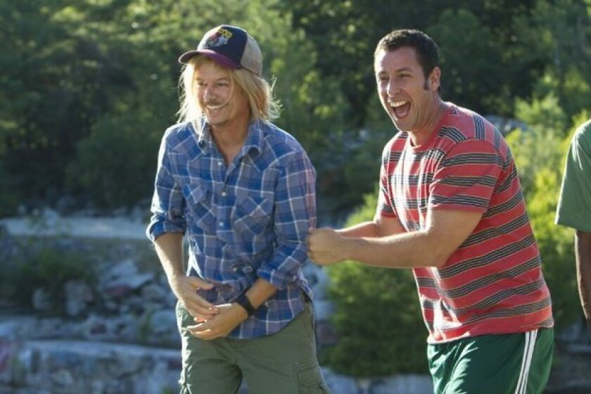 """Grown Ups 2,"" starring David Spade, left, and Adam Sandler, will fight for the top spot at the box office this weekend."