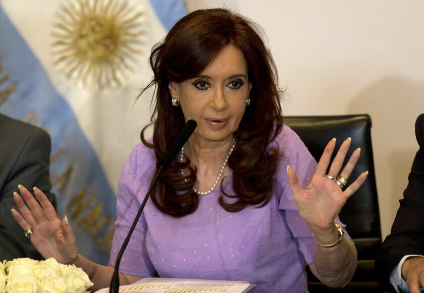 FILE - In this Feb. 11, 2015 file photo, Argentina's President Cristina Fernandez speaks during an event announcing new government projects at the government palace Casa Rosada, in Buenos Aires, Argentina. A federal judge on Thursday, Feb. 26, 2015 dismissed allegations by prosecutor Alberto Nisman that Fernandez tried to cover-up the alleged involvement of Iranian officials in the 1994 bombing of a Jewish center in Buenos Aires. (AP Photo/Rodrigo Abd, File)