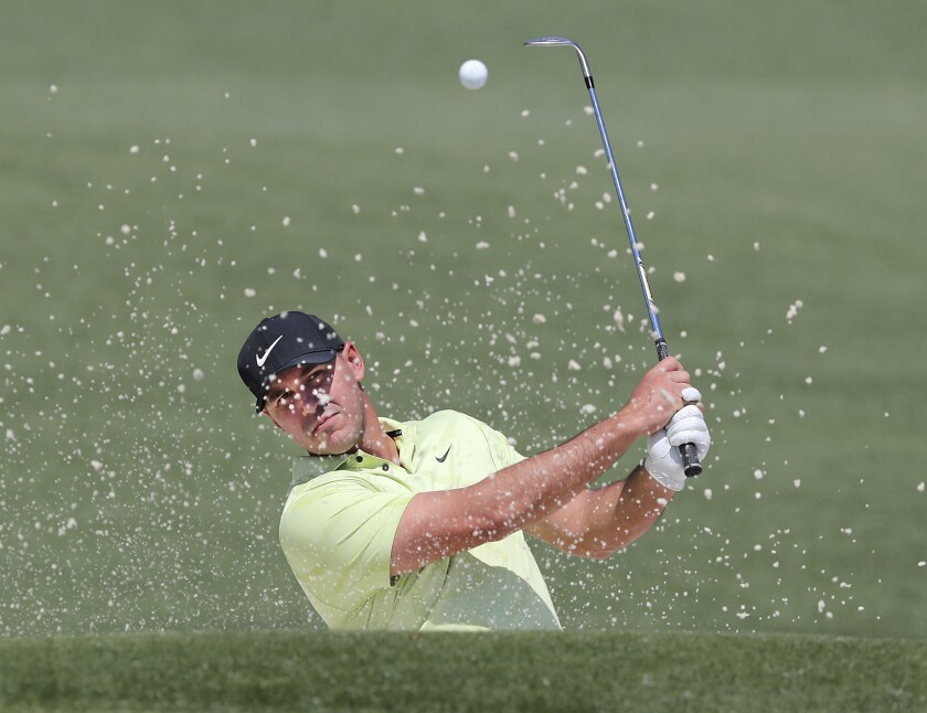 Brooks Koepka hits his bunker shot to the second green during a Masters practice round Tuesday.