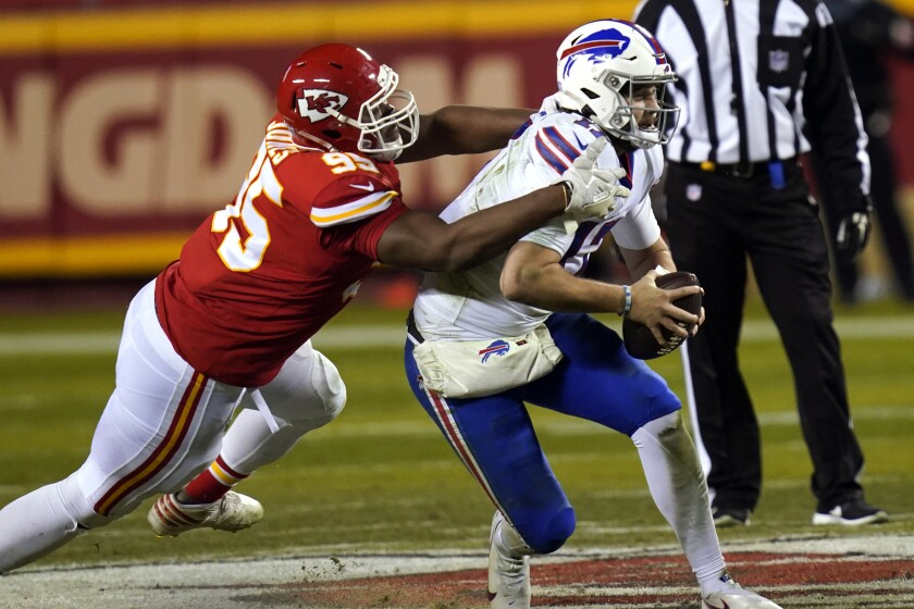 Kansas City Chiefs defensive tackle Chris Jones, left, tackles Buffalo Bills quarterback Josh Allen during the second half of the AFC championship NFL football game, Sunday, Jan. 24, 2021, in Kansas City, Mo. (AP Photo/Orlin Wagner)