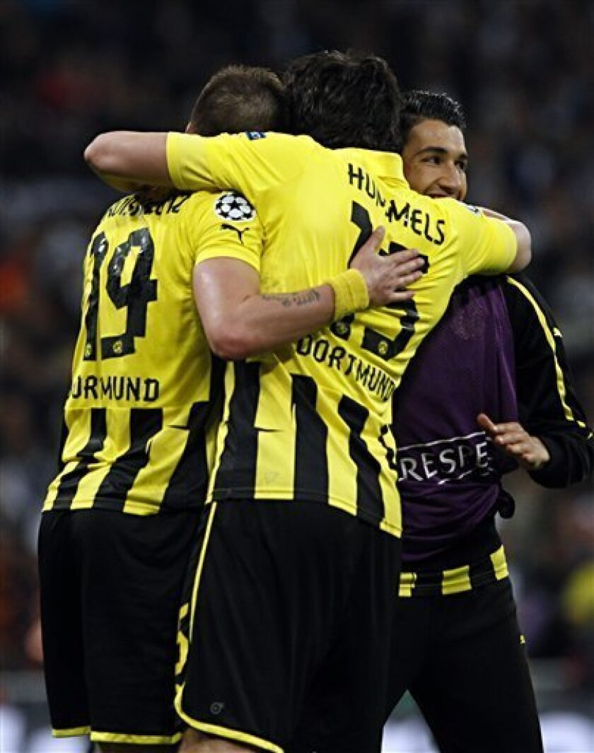 Dortmund's Kevin Grosskreutz, left, and Thomas Meissner celebrate after the Champions League semifinal second leg soccer match between Real Madrid and Borussia Dortmund at the Santiago Bernabeu stadium in Madrid, Spain, Tuesday April 30, 2013.  Real Madrid won 2-0 and Dortmund advances to the final