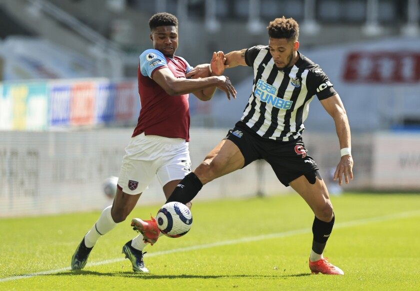 Newcastle's Joelinton, right, battles for the ball with West Ham's Ben Johnson during the English Premier League soccer match between Newcastle United and West Ham United at St James' Park, Newcastle, England, Saturday April 17, 2021. (AP Photo/Dave Rogers/Pool)
