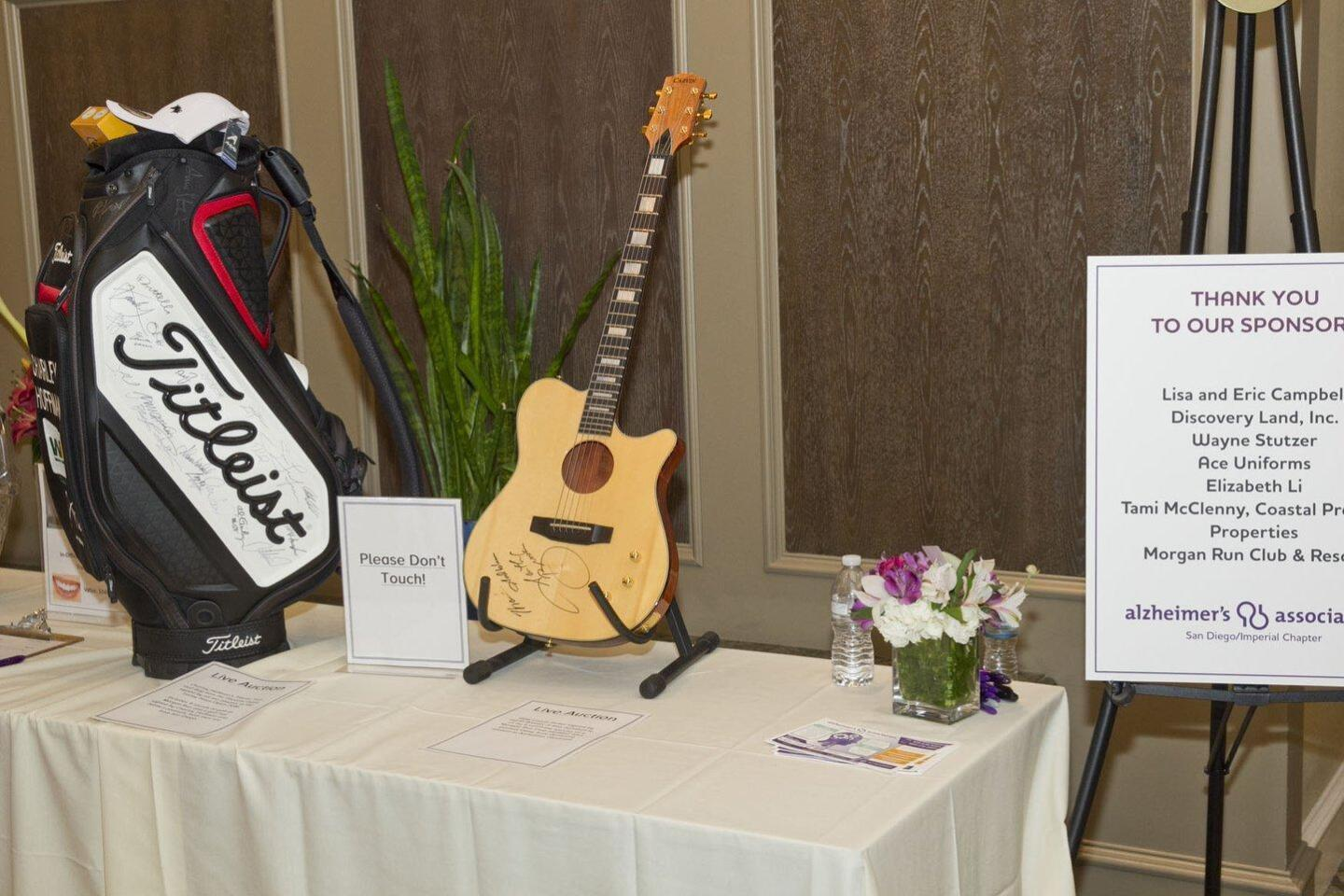 "Silent auction items at the Alzheimers Association ""Salute to Glen Campbell"""