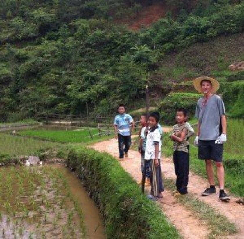 Tony Oliverio with children from a rural village in China.