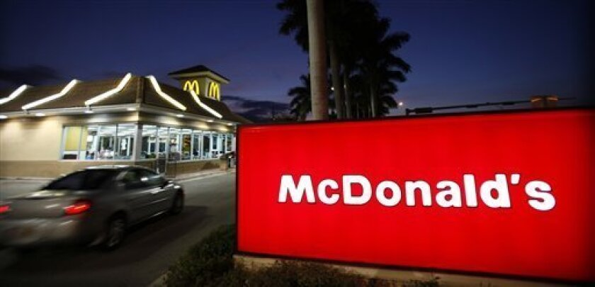 FILE - In this Jan. 20, 2010 file photo, a McDonald's restaurant is shown in Doral, Fla. McDonald's Corp. plans to hold its first national hiring day April 19, 2011, to fill 50,000 openings nationwide, seeking to lure new employees in a tough job market.(AP Photo/Wilfredo Lee, file)