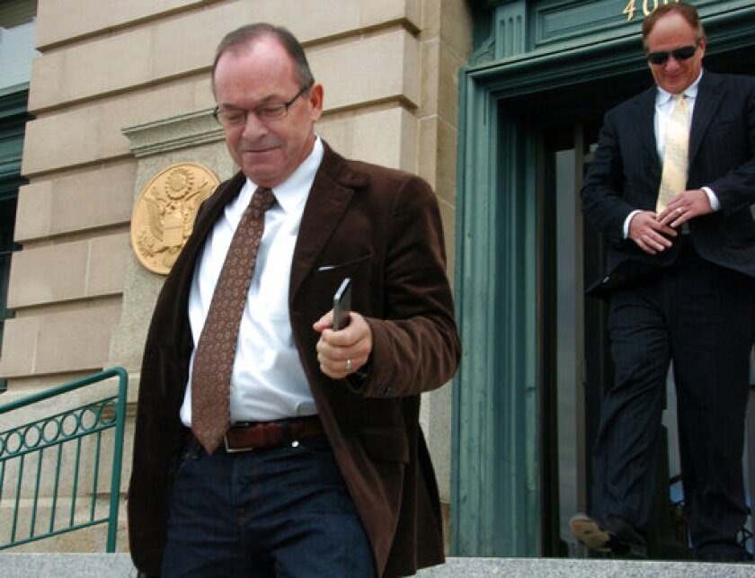 FILE - In this Nov. 3, 2014 file photo, Tim Blixseth, left, leaves a U.S. courthouse after facing questions about his finances in Butte, Mont.. A U.S. bankruptcy judge has dismissed an attempt by state officials to force the developer of Montana's Yellowstone Club resort into bankruptcy as a way to collect taxes he allegedly owed. (AP Photo/Matthew Brown, File)