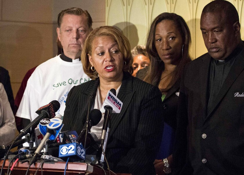 Annette Nance-Holt, who lost her 16-year-old son, Blair to gun-violence in 2007, speaks at a news conference in Chicago, Tuesday, July 7, 2015. Chicago has its first African American female fire commissioner. Annette Nance-Holt was confirmed to the post by the City Council on Wednesday, June 23, 2021. She previously was first deputy commissioner. She will replace Richard Ford, who retired earlier this year. (Saiyna Bashir/Chicago Sun-Times via AP)