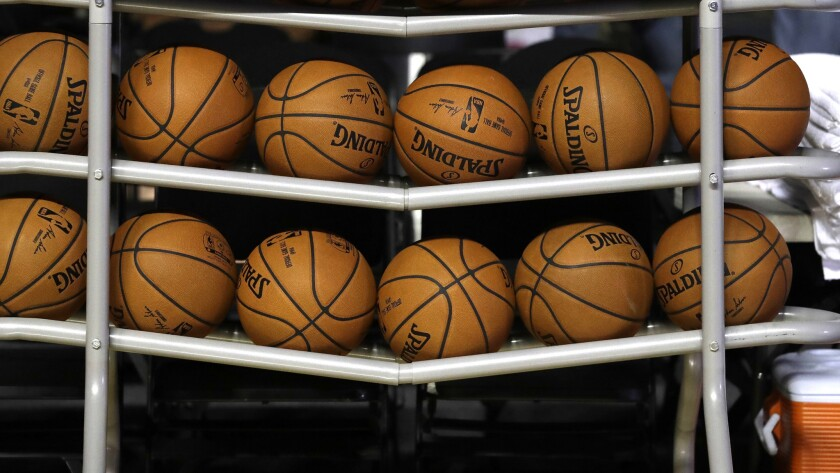 Basketballs sit in a rack on the court during a training session by the Brooklyn Nets at the Mexico City Arena in Mexico City, Wednesday, Dec. 6, 2017. The Brooklyn Nets will play two regular season games in Mexico City, facing the Oklahoma City Thunder on Thursday, and the Miami Heat on Saturday. (AP Photo/Rebecca Blackwell)