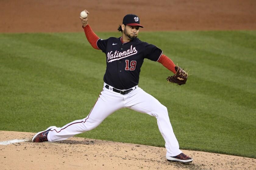 El abridor de los Nacionales de Washington Aníbal Sánchez trabaja en el tercer inning del juego ante los Filis de Filadelfia, el lunes 21 de septiembre de 2020, en Washington. (AP Foto/Nick Wass)