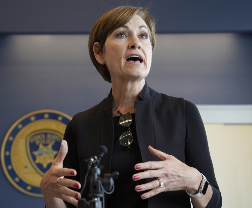 FILE - in this April 26, 2019 file photo, Iowa Gov. Kim Reynolds, speaks to reporters following a meeting in Council Bluffs, Iowa. Felons would be required to repay restitution to victims before they could get their voting right restored under a bill passed by the Iowa Senate. Earlier Tuesday, March 3, 2020, Reynolds for the first time indicated support for the measure. (AP Photo/Nati Harnik File)