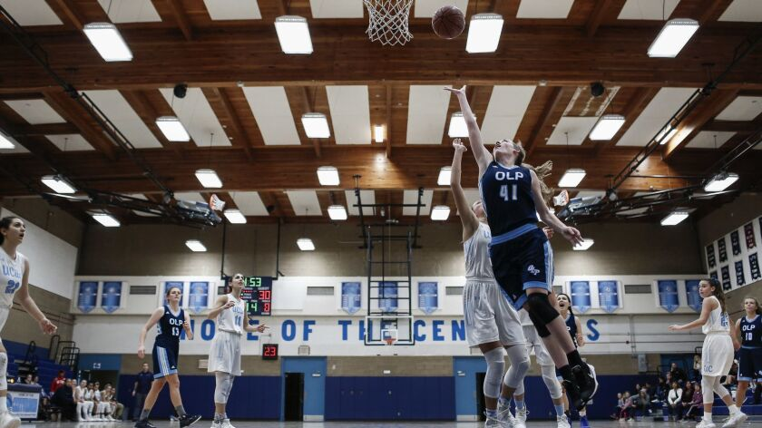 OLP forward Madison Lunde (41) shoots a layup in the fourth period against University City.