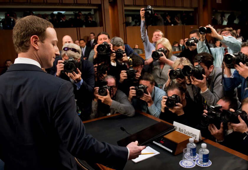 Facebook Chief Executive Mark Zuckerberg prepares to testify at a Senate hearing in Washington, D.C., in 2018.