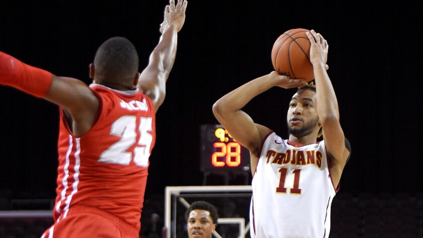 USC guard Jordan McLaughlin, shooting over New Mexico guard Tim Jacobs during a game Nov. 21, averages 12. 4 points, 5.2 assists and 1.7 steals a game.