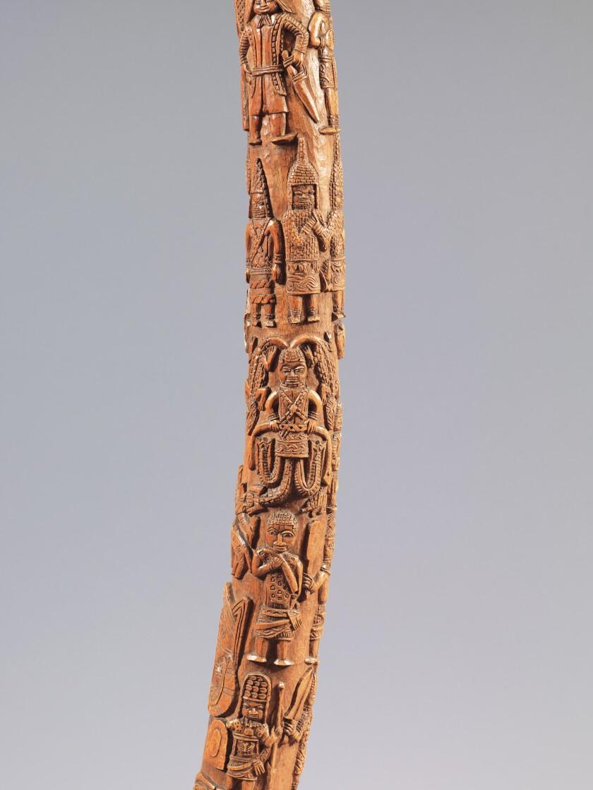 A closeup of intricate figurative interlace adorning a tusk