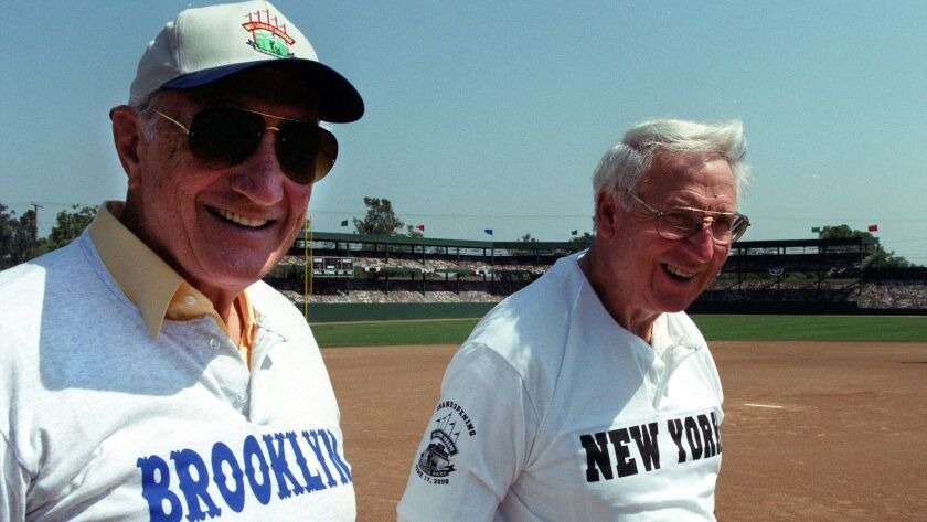 "Bobby Thompson(right) and Ralph Branca recreate ""the shot heard round the world"" at Big League Dreams in Chino Hills"
