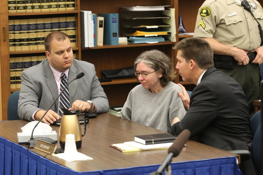 Jennifer Trayers, 43, is comforted by her co-counsels, Marc Kohnen, left, and Kerry Armstrong, right, after being sentenced to 16 years to life for fatally stabbing her Navy doctor husband in their North Park home.