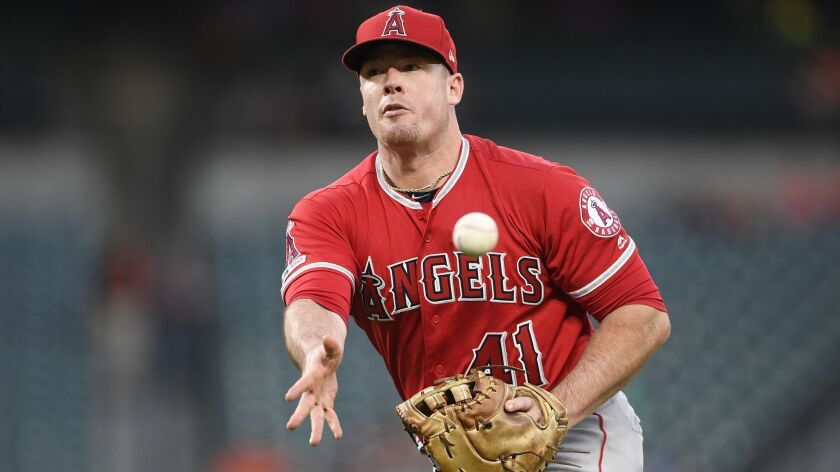 Los Angeles Angels first baseman Justin Bour (41) tosses the ball towards first during a baseball ga