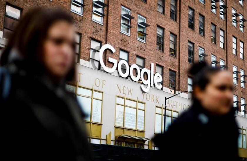Women walk past Google offices in New York on Dec. 17, 2018, the day it revealed plans to invest $1 billion in the construction of new offices there, an announcement that comes weeks after both Amazon and Apple made known their individual expansion projects in the Big Apple. EFE-EPA/Justin Lane