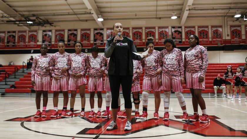 Assistant coach Jerica Williams, who played alongside Genvieve Costello at Mount Miguel, gave a speech before the game with the Lady Matadors behind her donned in pink.