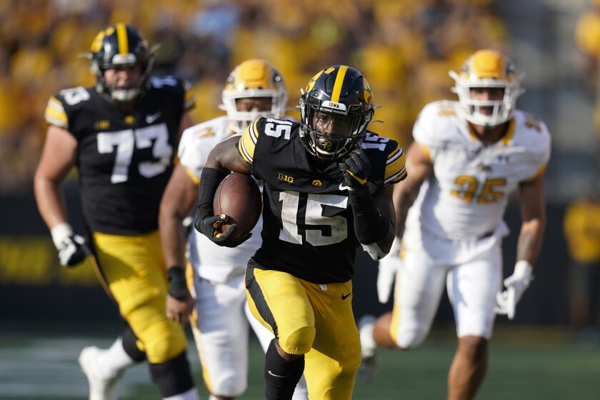 Iowa running back Tyler Goodson (15) runs up field during a 35-yard touchdown run in the second half of an NCAA college football game against Kent State, Saturday, Sept. 18, 2021, in Iowa City, Iowa. Iowa won 30-7. (AP Photo/Charlie Neibergall)