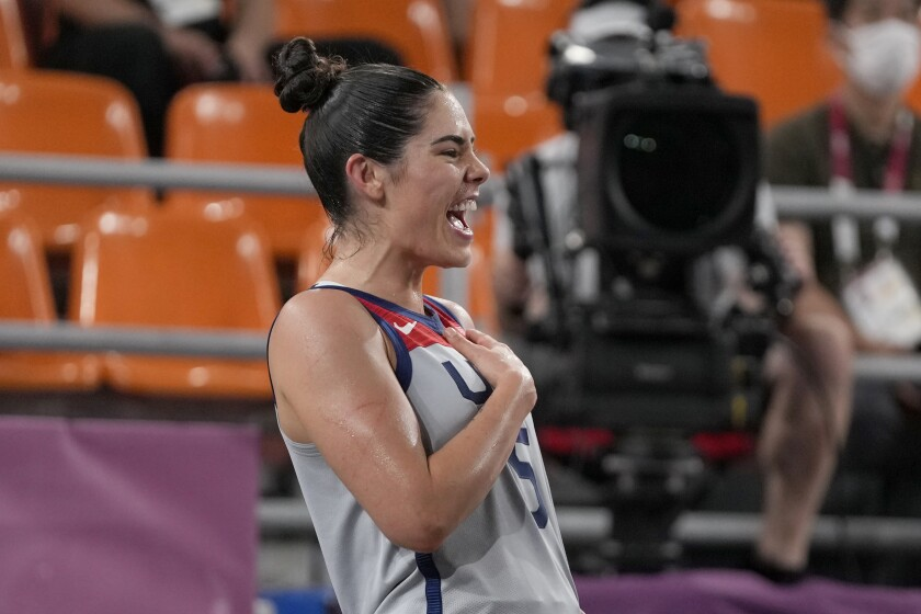 Kelsey Plum celebrates the U.S. victory over Russia in the gold medal game of women's 3x3 basketball.
