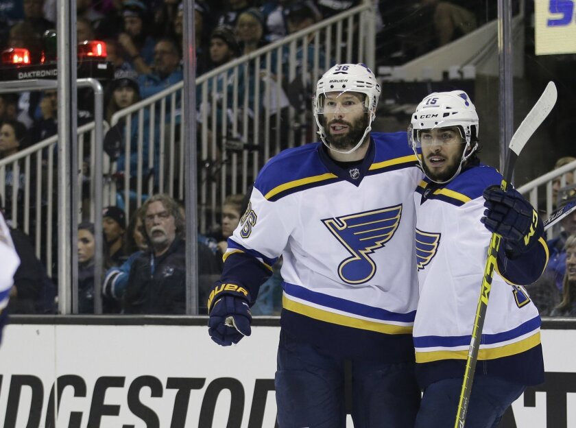 St. Louis Blues' Troy Brouwer, left, celebrates his goal with teammate Robby Fabbri during the first period in Game 4 of the NHL hockey Stanley Cup Western Conference finals against the San Jose Sharks on Saturday, May 21, 2016, in San Jose, Calif. (AP Photo/Marcio Jose Sanchez)
