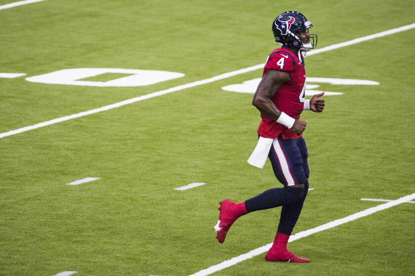 Houston Texans quarterback Deshaun Watson jogs onto the field at NFL football training camp Thursday, Aug. 27, 2020, in Houston. (Brett Coomer/Houston Chronicle via AP, Pool)