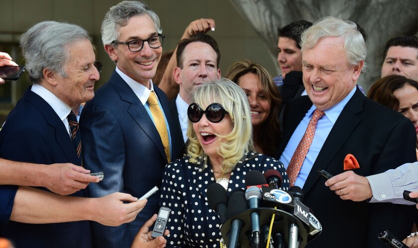 A happy Shelly Sterling speaks to the media Monday outside court in Los Angeles after a ruling favoring her deal to sell the Clippers to Steve Ballmer.